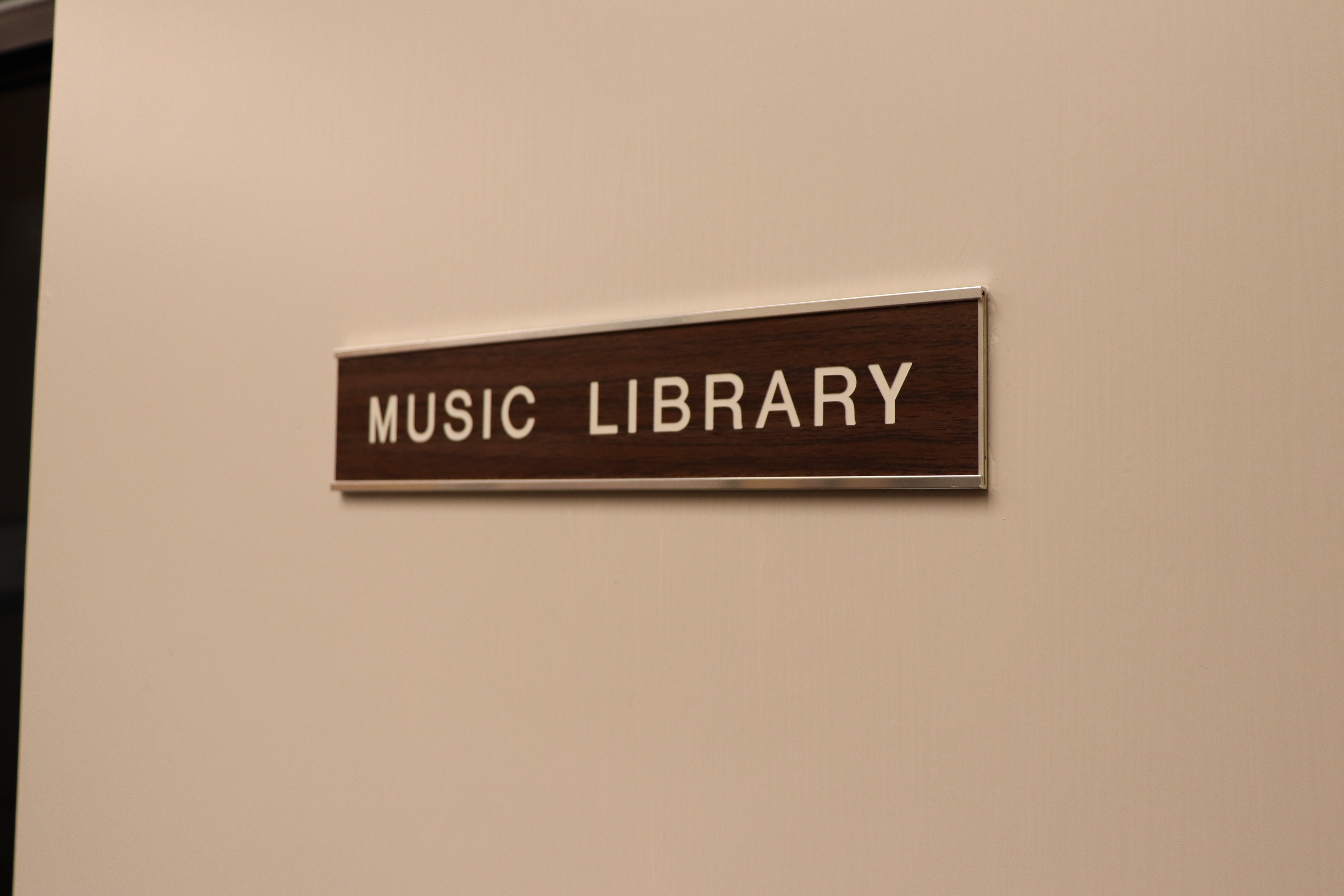 picture of a door sign with text words music library