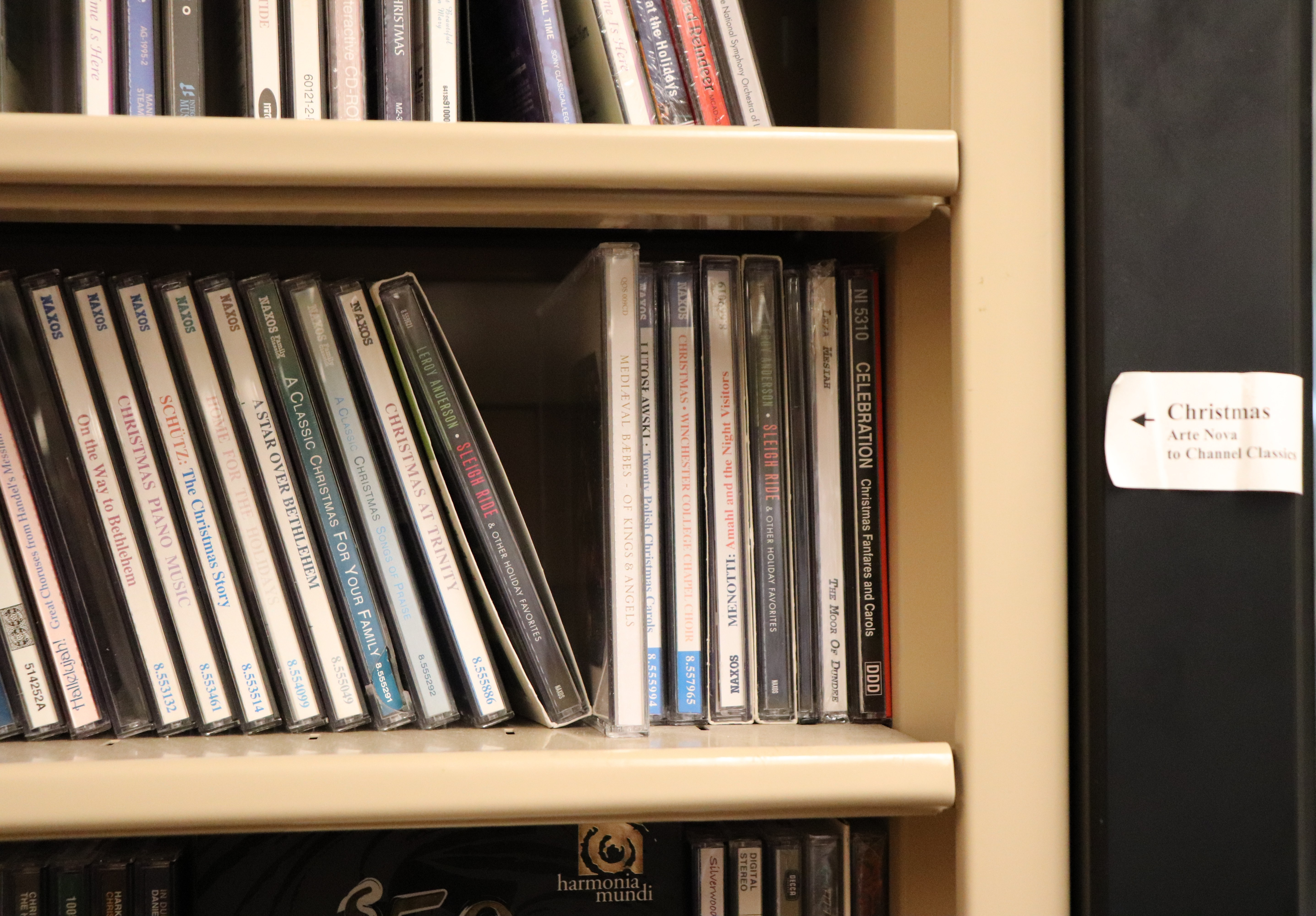 picture of a shelf of christmas cds