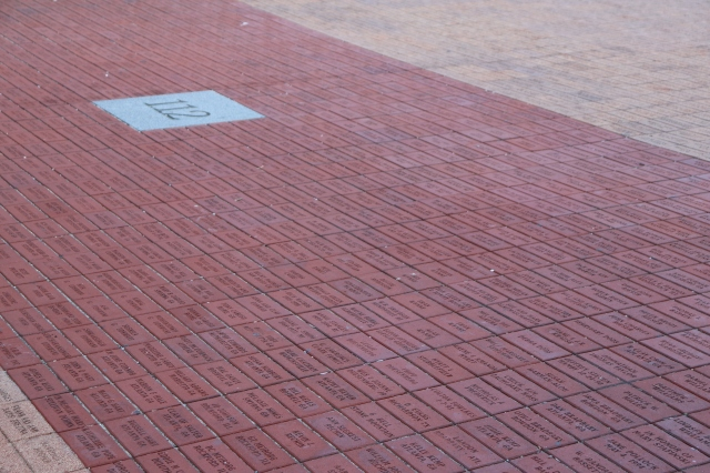 picture of red colored bricks with donor names on them