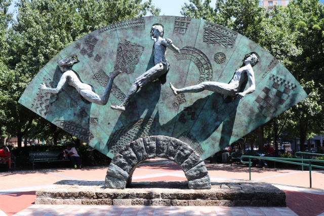 picture of a sculpture with three athletes