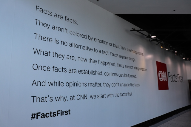 picture of a wall poster in CNN headquarters talking about the importance of truthful reporting.