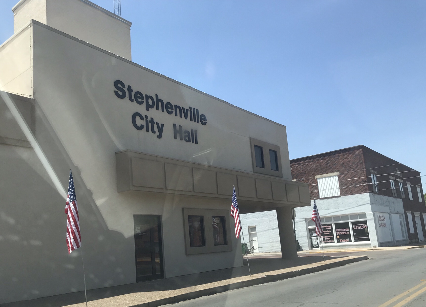 picture of a two story building used as the city hall of stephenville